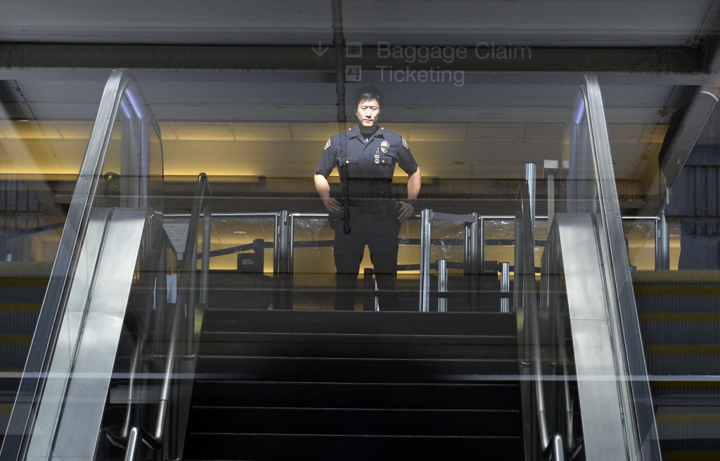A Los Angeles Airport Police officer stands in front of Terminal 3 security screeners, the site of shooting scene, after law enforcement official completed their investigation and prepare to re-open the terminal at Los Angeles International Airport November 2, 2013 in Los Angeles, California.