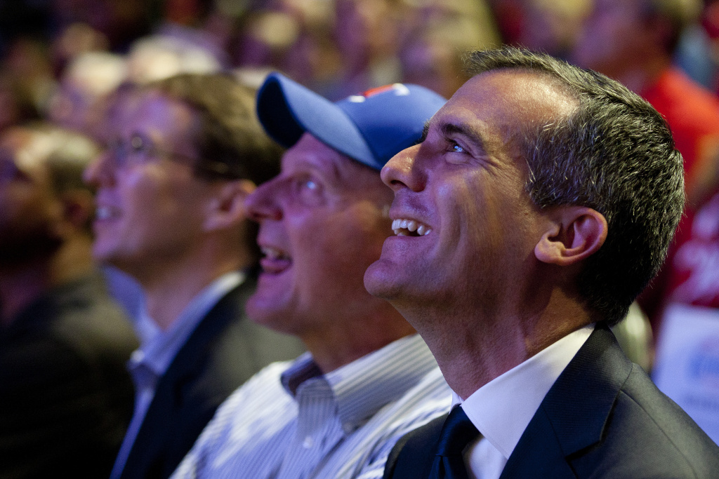 Los Angeles Mayor Eric Garcetti sits next to Clippers owner Steve Ballmer as they watch a highlight during a fan appreciation rally at the Staples Center.