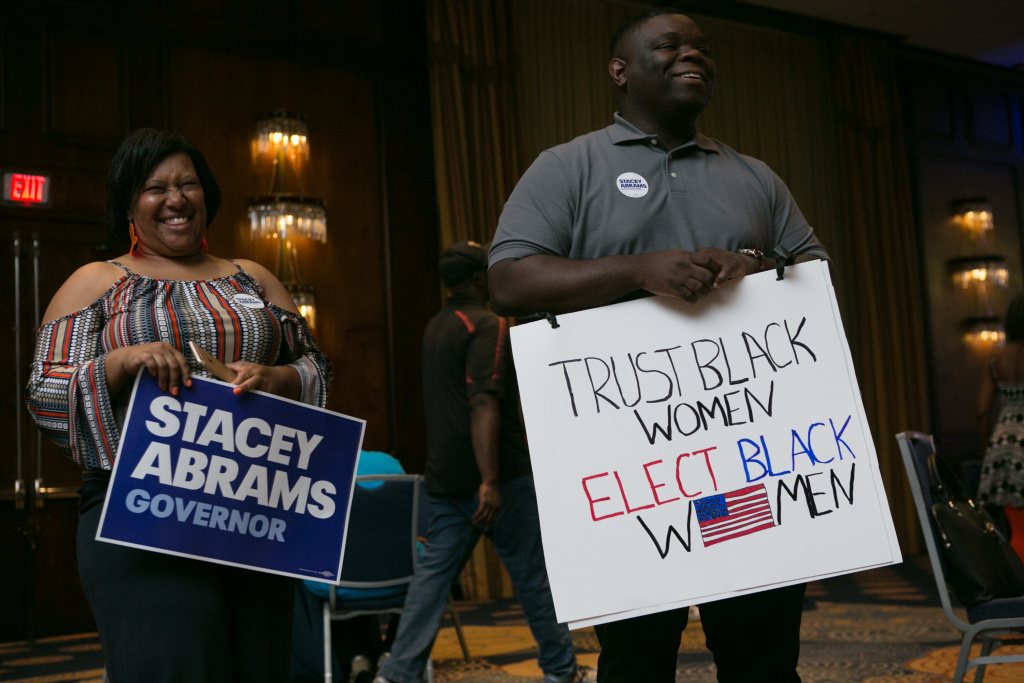 ATLANTA, GA - MAY 22: Supporters Denise Williams (left) and Darion Reed of Covington during the primary election night event for Georgia Democratic gubernatorial candidate Stacey Abrams on May 22, 2018 in Atlanta, Georgia. Abrams is running against former state representative Stacey Evans. (Photo by Jessica McGowan/Getty Images)