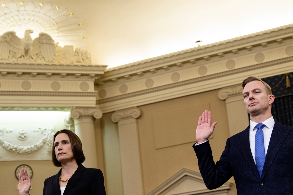 Fiona Hill, the former top Russia expert on the National Security Council, and David Holmes, a State Department official stationed at the US Embassy in Ukraine are sworn-in before they testify during the House Intelligence Committee hearing as part of the impeachment inquiry.
