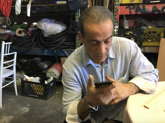 George Haratoonian, a Glendale resident, works at his party rental company in Atwater. Haratoonian, an Armenian Christian, arrived as a refugee from Iran years ago. His brother's family was getting ready to come to the United States when the Trump administration's travel ban took effect. The family has been unable to travel because their transit visas to Austria were canceled.