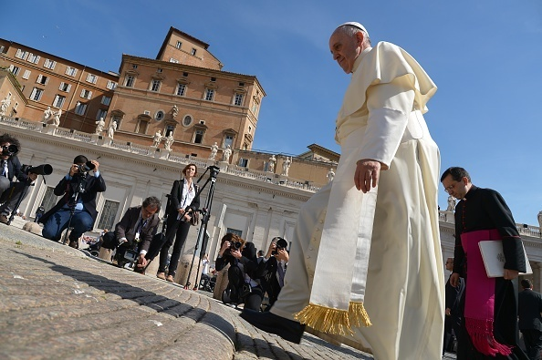 Pope Francis arrives for his general audience at St. Peter's square on May 13 at the Vatican.