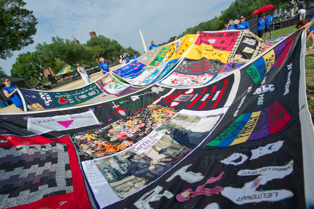 Volunteers lay out the AIDS Quilt on the National Mall on July 23, 2012 as part of the 19th International AIDS Conference in Washington, DC.