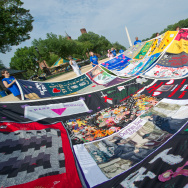 Volunteers lay out the AIDS Quilt on the
