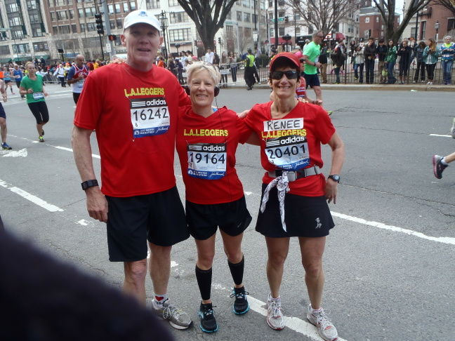 Renee Opell with friends Phil Kent and Jennifer Hartman at the Boston Marathon, mile 25. This photo was taken just minutes before the first blast.