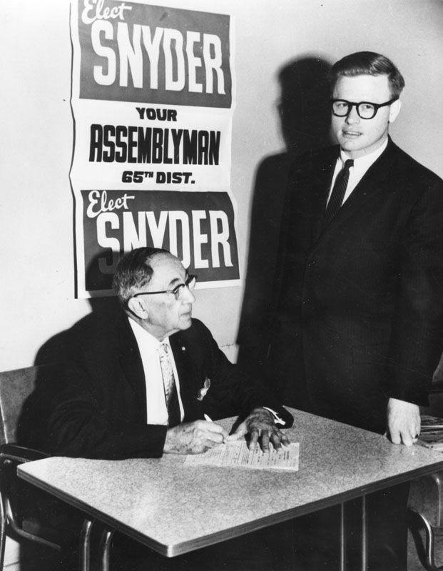 Art Snyder (right) with voter, 1967.
