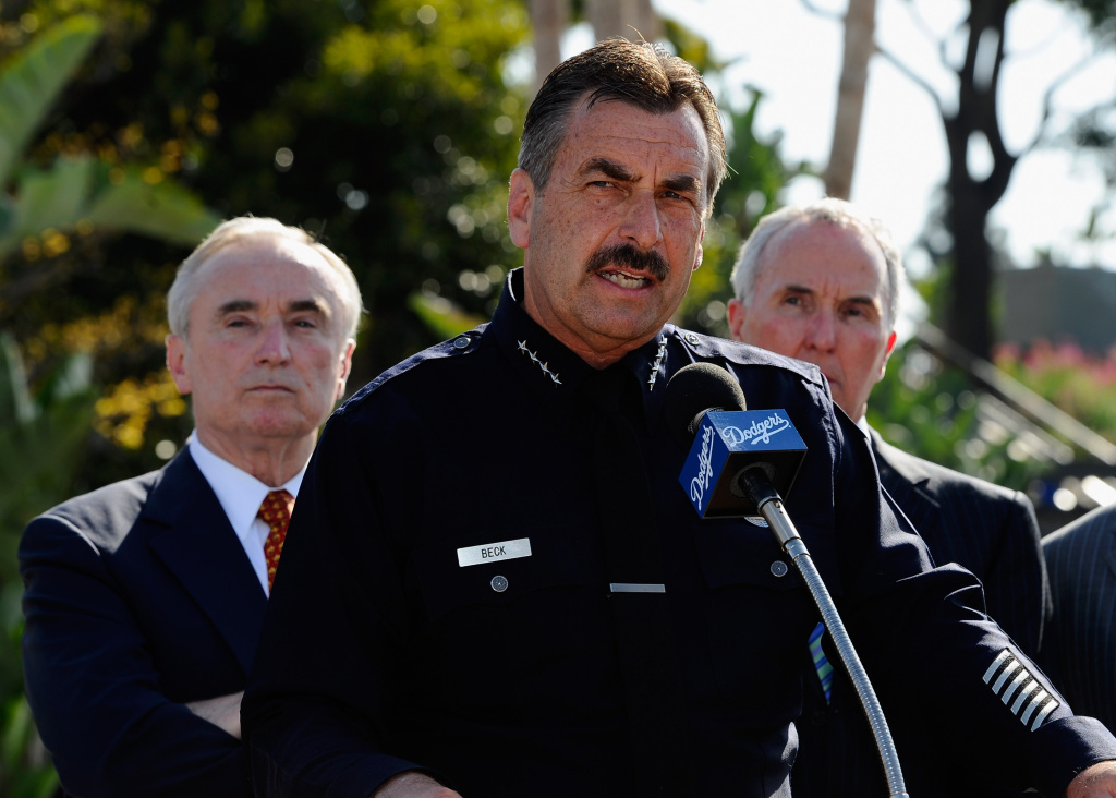 Los Angeles Police Department Chief Charlie Beck (C) speaks during a news conference at Los Angeles Dodger Stadium on April 14, 2011 in Los Angeles, California.
