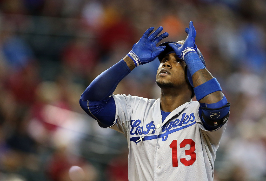 Hanley Ramirez #13 of the Los Angeles Dodgers reacts after hitting a solo home run against the Arizona Diamondbacks during the seventh inning of the MLB game at Chase Field on Sept. 19, 2013 in Phoenix, Arizona.