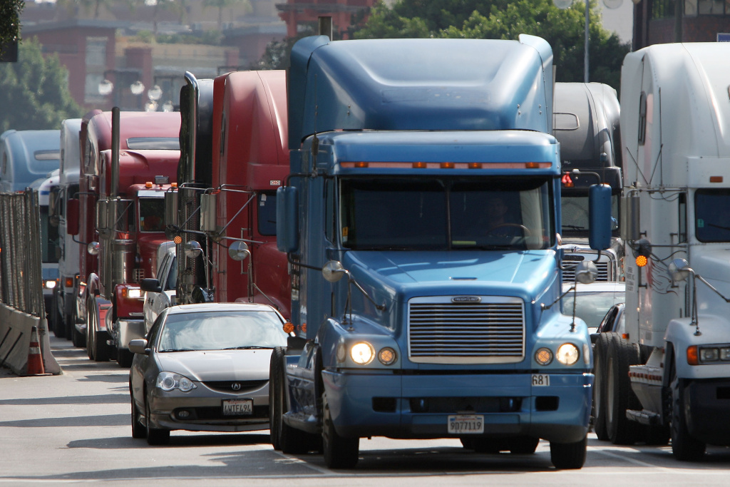 Trucks drive near City Hall to protest shipping container fees being assessed against independent truckers as part of the ports' Clean Truck Program to allow only newer, less-polluting trucks at the ports, on November 13, 2009 in Los Angeles, California.