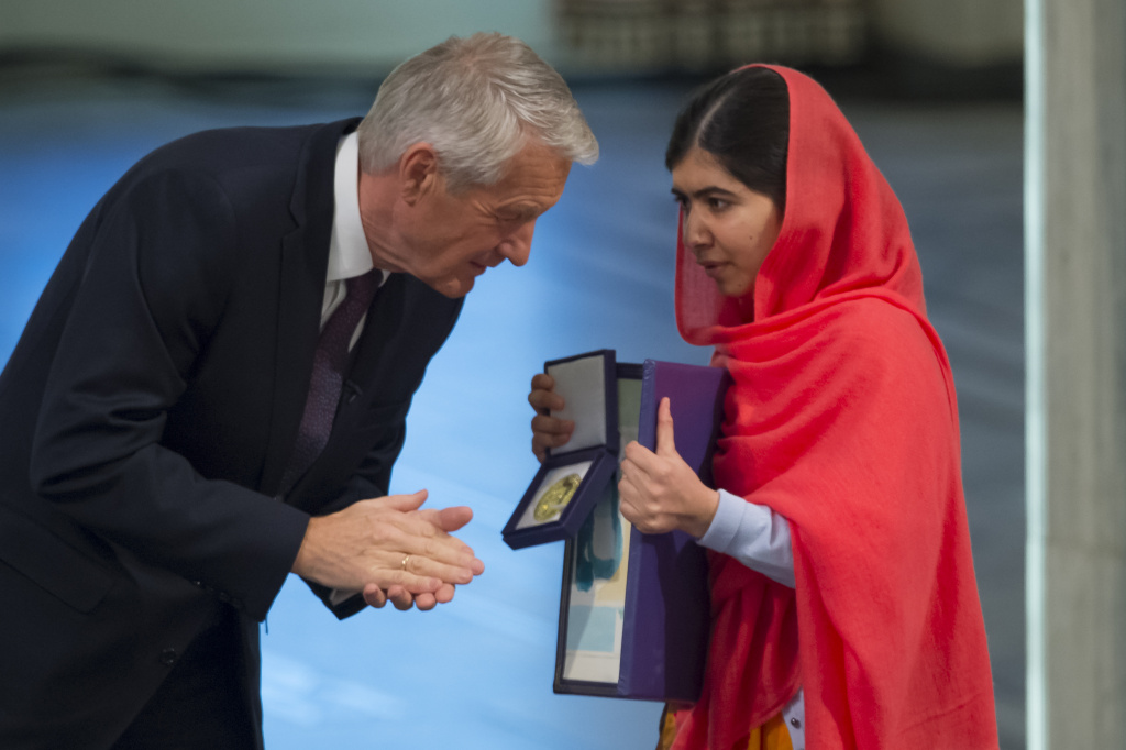 Thorbjorn Jagland of Norway and Malala Yousafzai accepts the Nobel Peace Prize Award during the Nobel Peace Prize ceremony at Oslo City Town Hall on December 10, 2014 in Oslo, Norway.