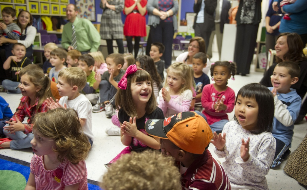 Students clap after Kathy Duritza, a pre-school teacher at the North Hills KinderCare Learning Center in Pittsburgh, Pennsylvania.