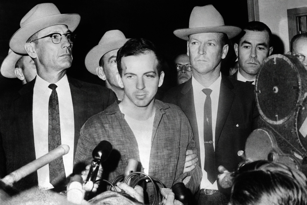 Picture dated 22 November 1963 of US President John F. Kennedy's murderer Lee Harvey Oswald during a press conference after his arrest in Dallas. Lee Harvey Oswald was killed by Jack Ruby on 24 November on the eve of Kennedy's burial. AFP PHOTO / AFP / STRINGER        (Photo credit should read STRINGER/AFP/Getty Images)