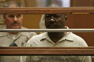 Suspected killer Lonnie David Franklin Jr., dubbed the 'Grim Sleeper' for a 13-year break between his strings of 11 murders, is pictured during his arraignment in Los Angeles Criminal Courts on July 8, 2010.