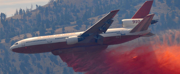 In this Sept. 5. 2011 file photo, a DC-10 airplane drops retardant to help put out the wildfire in Tehachapi, Calif. on.