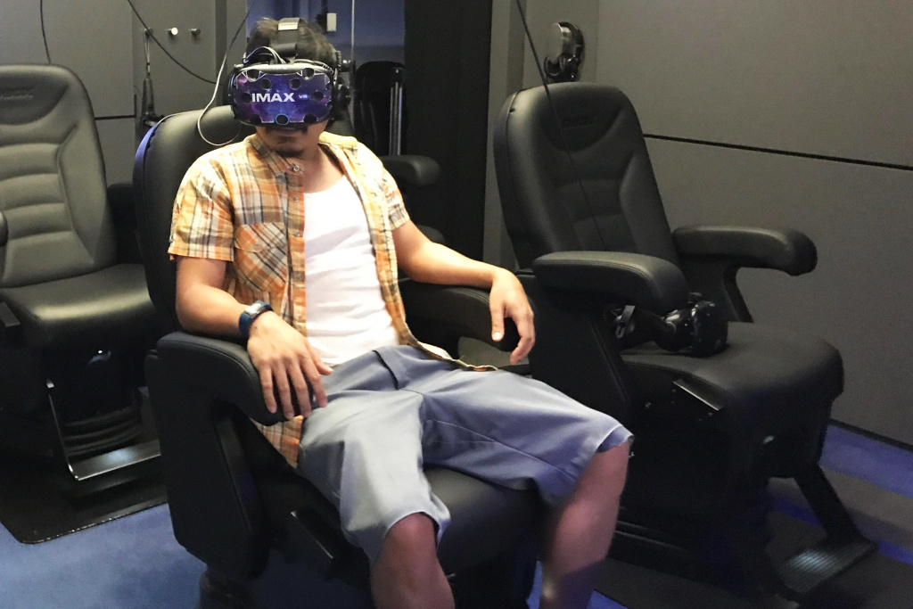 "Patrick Epino tries the ""Raising a Ruckus"" VR experience at the IMAX VR Centre in Los Angeles."