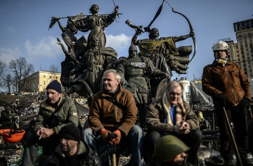 Anti government protesters attend a rally on Independence square on February 21, 2014 in Kiev. Ukrainian President Viktor Yanukovych and three main opposition leaders signed a deal Friday to end a three-month crisis over the ex-Soviet country's political future that has led to nearly 100 deaths. The pact paving the way for early elections and a shift in political power toward parliament was signed in the Blue Hall of the presidential palace in the presence of three EU envoys, an AFP correspondent said.