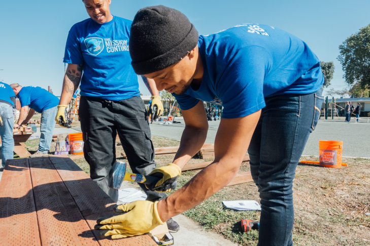 The Mission Continues fellow Stephanie Lewis (left) joins volunteer Da'karie Montes, an Army veteran, constructing a picnic table at Gonzaque Village in Watts.