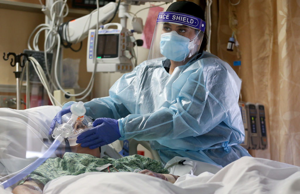 A clinician cares for a COVID-19 patient in the Intensive Care Unit (ICU) at Providence St. Mary Medical Center amid a surge in COVID-19 patients in Southern California on December 23, 2020 in Apple Valley, California.