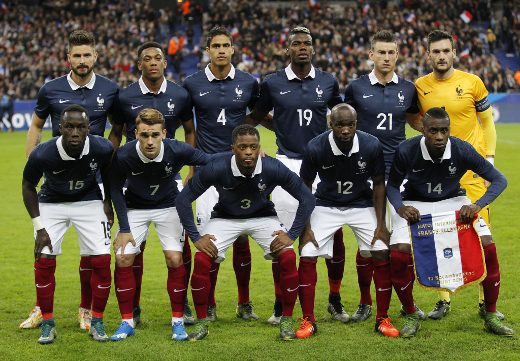 France's team front row from left,,  Bacary Sagna, Antoine Griezmann, Patrice Evra, Lassana Diarra and Blaise Matuidi, back row from left, France's Olivier Giroud, Anthony Martial Anthony, Raphael Varane, Paul Pogba, Laurent Koscielny and goalkeeper Hugo Lloris during their international friendly soccer match France against Germany at the Stade de France stadium in Saint Denis, outside Paris, Friday Nov. 13, 2015 in Paris, (AP Photo/Michel Euler)