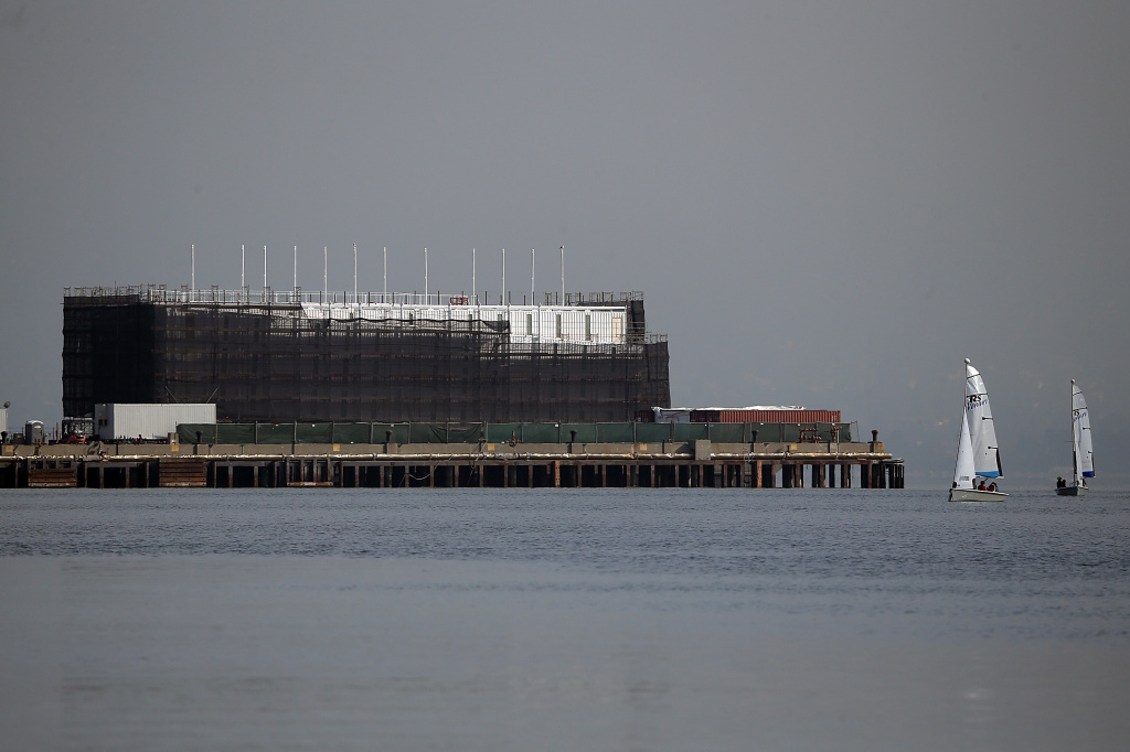 A barge under construction is docked at a pier on Treasure Island on October 30, 2013 in San Francisco, California.  Mystery barges with construction of shipping containers have appeared in San Francisco and Portland, Maine, prompting online rumors that the barges are affiliated with a Google project.
