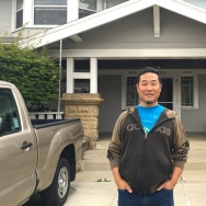 Artist Alan Nakagawa in front of his home in Koreatown