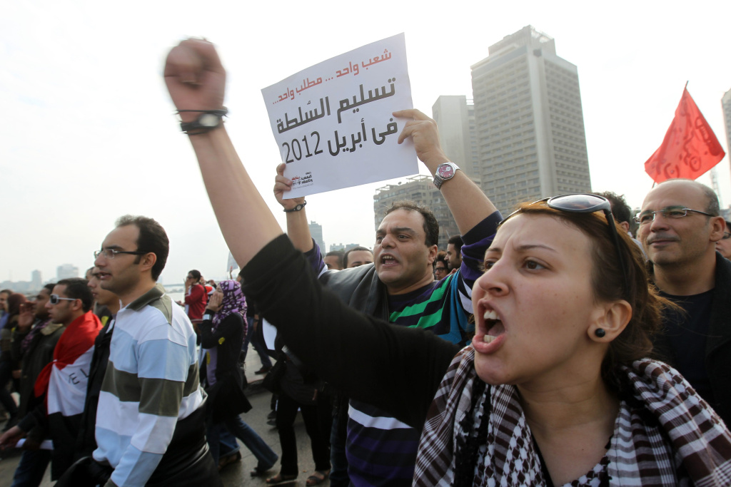 Egyptian protesters shout slogans during a rally in Cairo's landmark Tahrir Square on November 18, 2011.