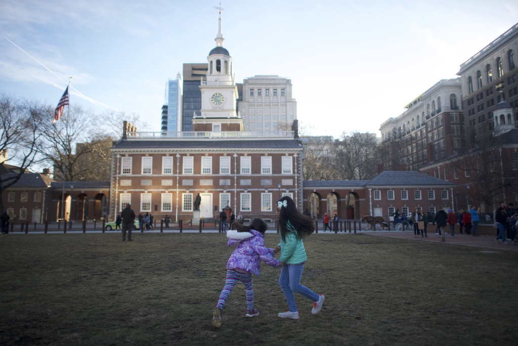 Girls play in front of Independence Hall on January 20, 2018 in Philadelphia, Pennsylvania.