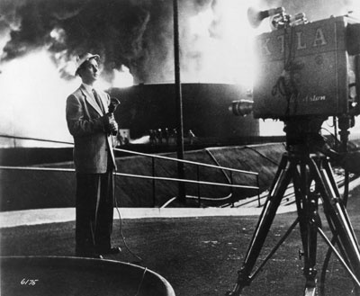 Veteran KTLA Channel 5 reporter Stan Chambers reports live from the scene of a 1951 refinery fire in Los Angeles' Wilmington district.