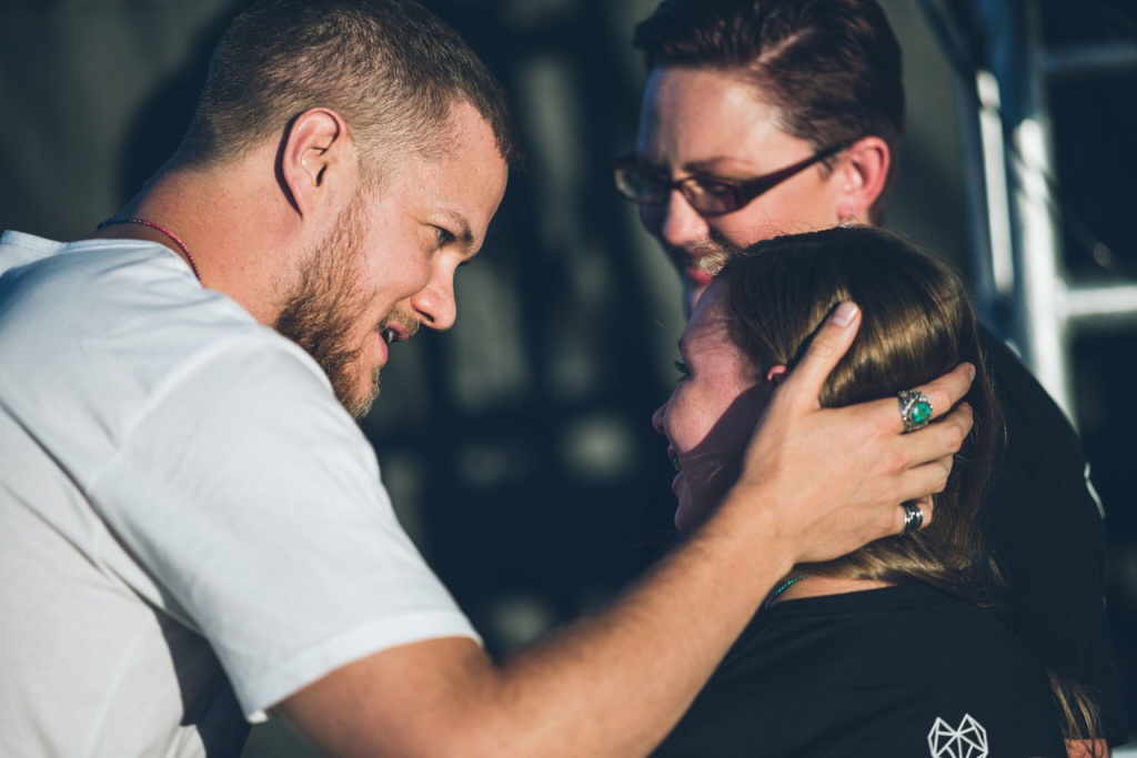 Dan Reynolds greets Savannah and her mother, Heather Kester, after Savannah's speech at the 2017 LoveLoud Festival in Orem, Utah.