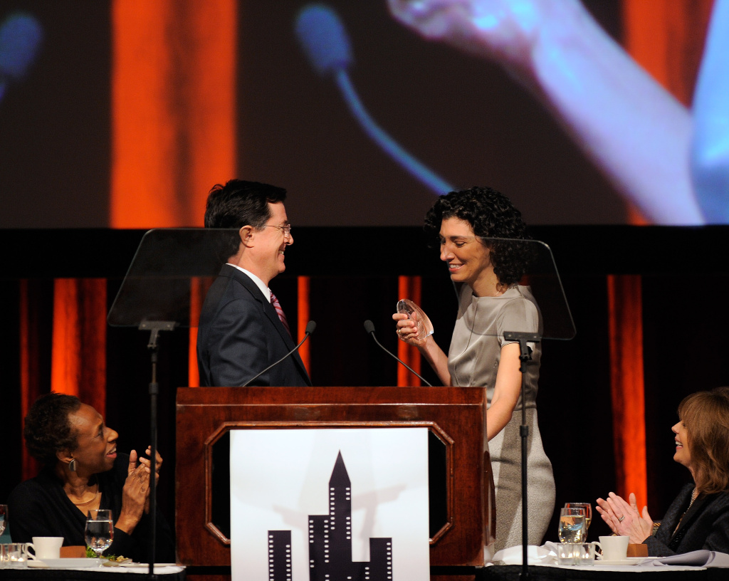 Stephen Colbert presents a Muse Award to his former head writer and executive producer Allison Silverman at the New York Women in Film & Television 29th Annual Muse Awards in December, 2009 in New York City.