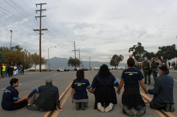 Riverside County sheriff's deputies arrested 6 protestors who blocked entry to Wal-Mart-affiliated NFI Industries in Mira Loma Thursday. Workers say they're being retaliated against for demanding basic workplace improvements.