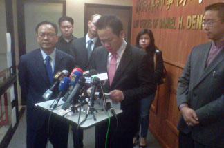 San Gabriel Mayor Albert Huang resigns at a news conference October 19, 2010