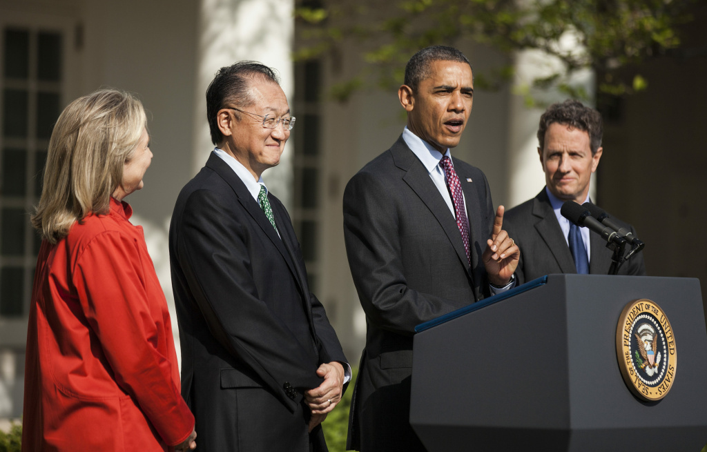 US Secretary of State Hillary Rodham Clinton (L), Dartmouth College President Jim Yong Kim (2nd L) and US Secretary of the Treasury Timothy F. Geithner (R) listen while US President Barack Obama speaks in the Rose Garden of the White House on March 23, 2012 in Washington, DC. President Obama announced his nomination of Kim to succeed Robert Zoellick as President of the World Bank.