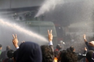 Egyptian demonstrators confront riot police during a demonstration in Cairo on January 28, 2011, demanding the ouster of President Hosni Mubarak.