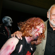 "Director George A. Romero (R) and a zombie arrive at the ""Survival of the Dead"" Midnight Madness screening at the 2009 Toronto International Film Festival."