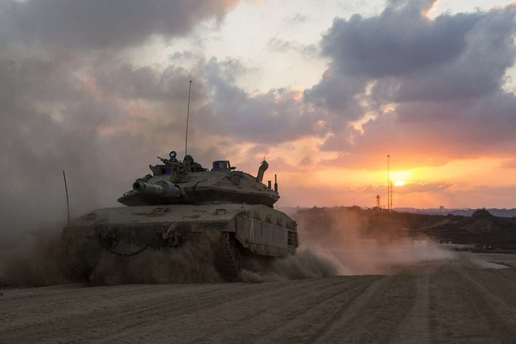 An Israeli Merkava tank rolls back from the Gaza Strip to an army deployment near Israel's border with the Palestinian enclave on Aug. 3, 2014.