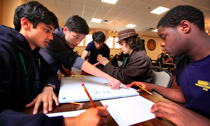 The North Hollywood High School team Los Angeles, CA concentrate on mapping out a magnetic field in the first round of the high school division team challenge competition at the U.S. Department of Energy National Science Bowl in Washington DC on April 27, 2012.