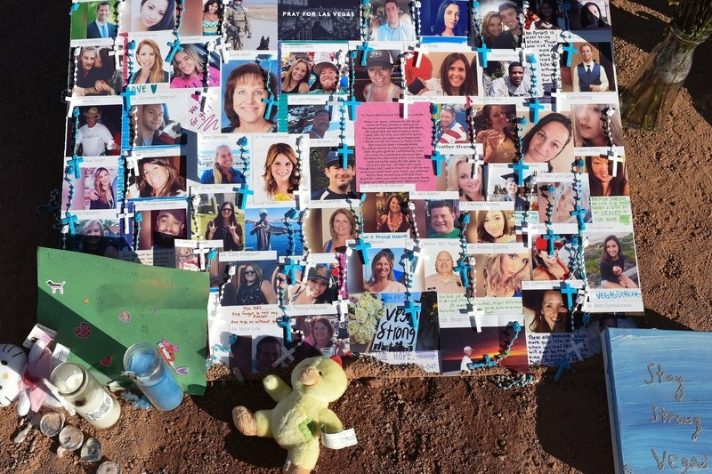A makeshift memorial on the south end of the Las Vegas Strip a few days after the shooting has photos of some of those who were killed.