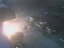 An image from a video showing a man who was burned when someone threw a fire bomb at him outside of a Long Beach market.