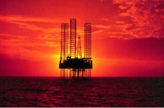 An Oil Exploration Drilling Rig In The Gulf Of Mexico During Sunset