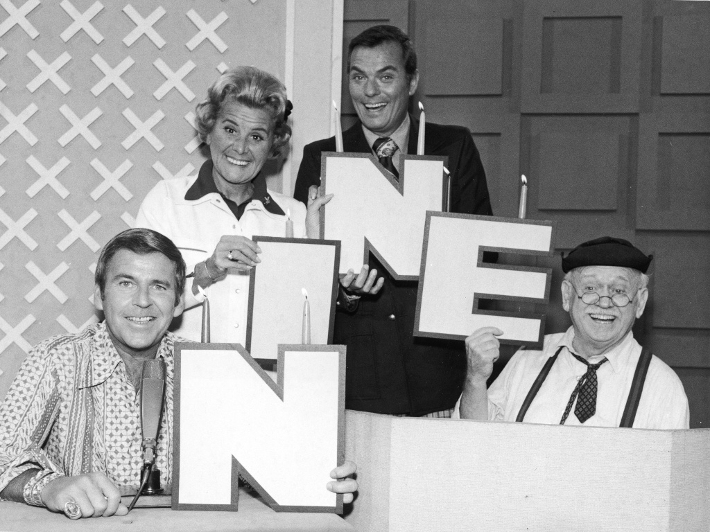 The celebrity panel and host of the game show 'Hollywood Squares' celebrate the 1974 season: Paul Lynde, Rose Marie, host Peter Marshall and Charley Weaver.