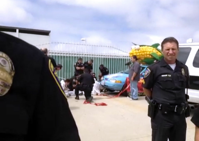 Nine anti-genetic foods activists were arrested Wednesday, Sept. 13, 2012 for blocking the gates to a large Southern California seed plant at a Monsanto subsidiary.