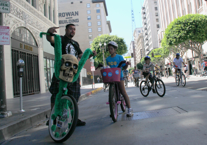 Riders pose for a picture at L.A.'s third CicLAvia event on October 9, 2011.