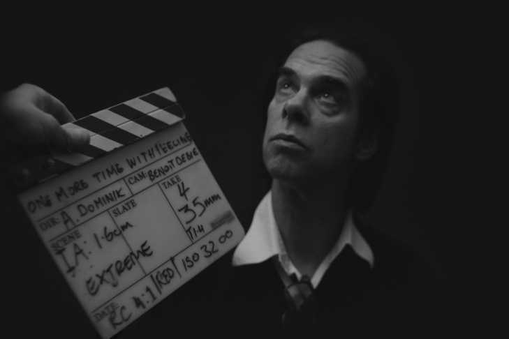 Nick Cave writes in his lyrics notebook on the set of