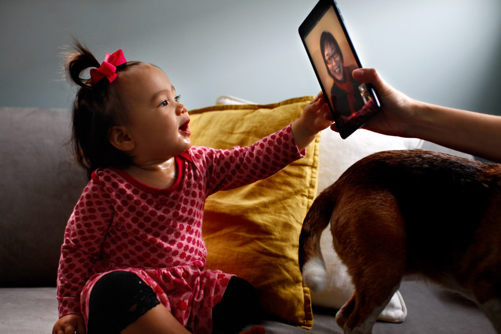 Eva Hu-Stiles virtually interacts with her grandmother. iPad assist by Elise Hu-Stiles.