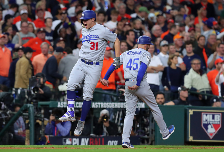Joc Pederson of the Los Angeles Dodgers celebrates after hitting a three-run home run during the ninth inning against the Houston Astros in game four of the 2017 World Series.