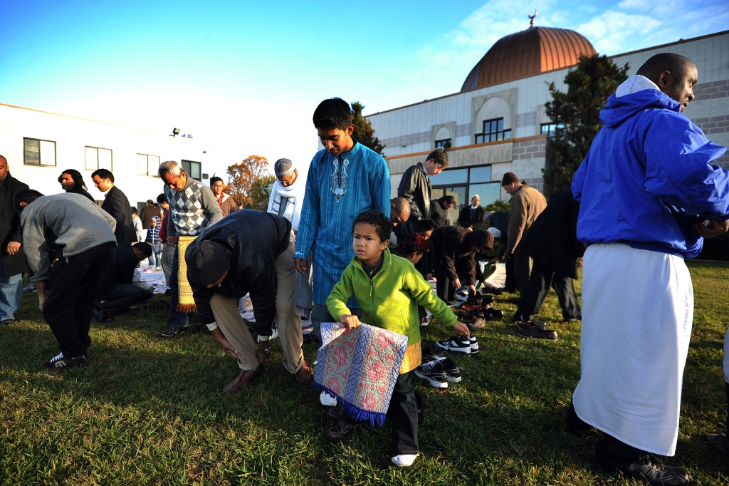 Muslim devotees leave after taking part in a special morning prayer to mark the start of Eid-al-Adha festival at mosque in Silver Spring, Maryland, on November 6, 2011.