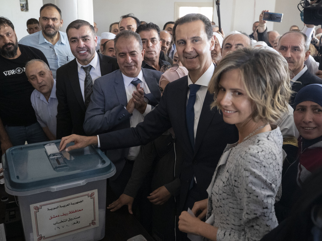 Syrian President Bashar al-Assad and his wife Asma vote at a polling station on Wednesday during the presidential elections in the town of Douma, near the Syrian capital Damascus.