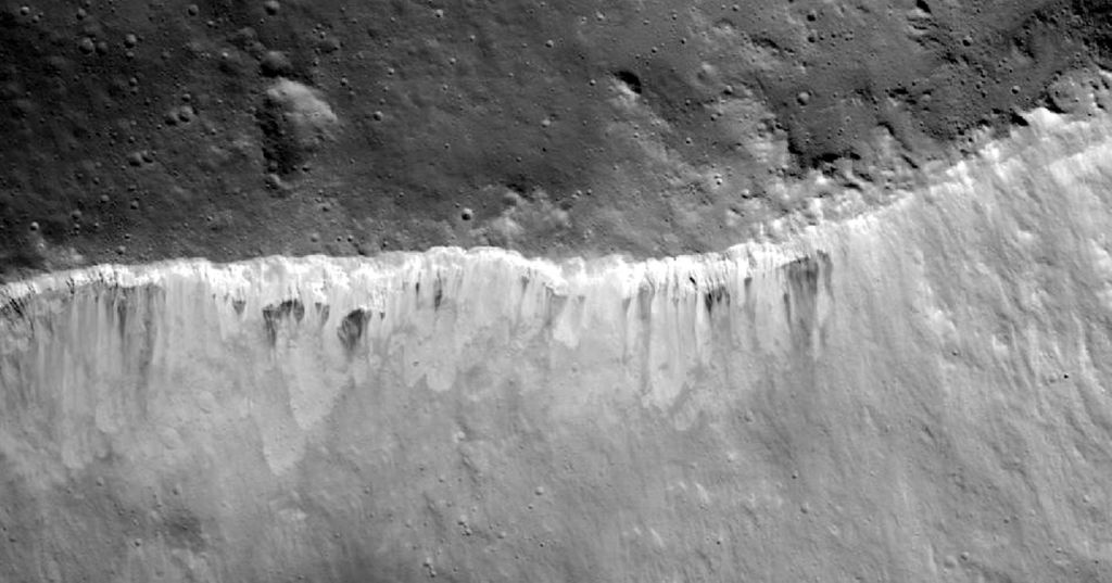 This Jan. 5, 2012 image provided by NASA shows bright and dark material at the rim of the Marcia crater on the Vesta asteroid, taken by NASA's Dawn spacecraft. The lighter areas of the crater's edge is causing high interest and speculation by NASA scientists.