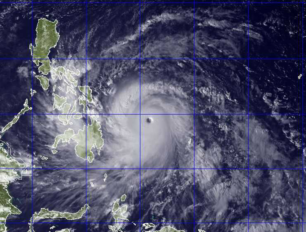 This image provided by the U.S. Naval Research Lab shows Typhoon Haiyan taken by the NEXSAT satellite Thursday Nov. 7, 2013 at 2:30 a.m. EDT. Gorvernment forecasters said Thursday that Typhoon Haiyan was packing sustained winds of 215 kilometers (134 miles) per hour and ferocious gusts of 250 kph (155 mph) and could pick up strength over the Pacific Ocean before it slams into the eastern Philippine province of Eastern Samar on Friday. (AP Photo/US Naval Research Lab)